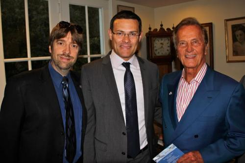 Producer Mike Flint with the Consul-General of Israel in Los Angeles, David Siegel, and Pat Boone