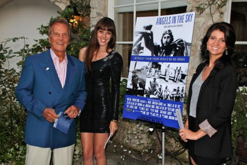 Pat Boone by our hostesses with our movie poster