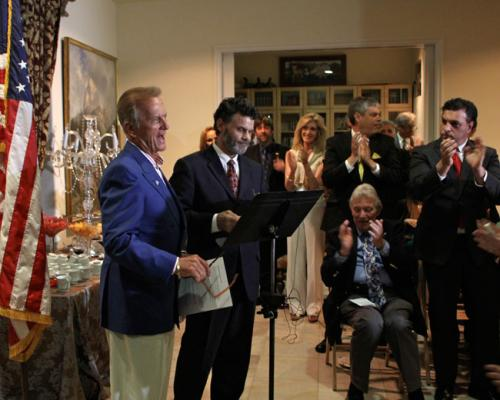 The audience welcomes Pat Boone